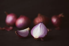 Free Full And Half Cut Spanish Onions On Dark Background. Stock Image - 96022241