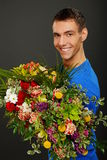 Full armful of flowers Stock Images