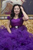 Full Asian woman in a lush lilac dress. Royalty Free Stock Photography