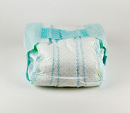 Full baby diaper on a white background Stock Photos