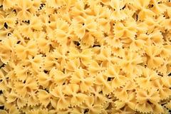 Full background of raw farfalle pasta. Full background of raw farfalle Royalty Free Stock Photos
