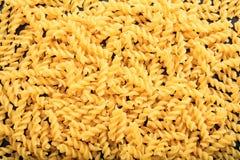 Full background of raw fusilli pasta. Full background of raw fusilli Royalty Free Stock Photo