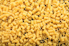 Full background of raw macaroni pasta. Full background of raw macaroni Royalty Free Stock Photography