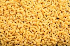 Full background of raw macaroni pasta. Full background of raw macaroni Royalty Free Stock Images
