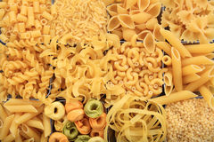 Full background of raw pasta. Various shapes Royalty Free Stock Image