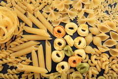 Full background of raw pasta. Various shapes Stock Photo