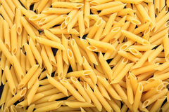 Full background of raw penne pasta. Full background of raw penne Stock Photos