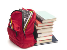 Full backpack and school textbooks royalty free stock images
