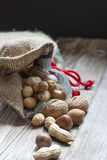 Full bag of nuts and almonds. Bag full of bio nuts and almonds royalty free stock photography