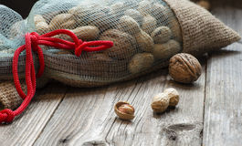 Full bag of nuts. Broken nuts and one full bag of them Royalty Free Stock Images