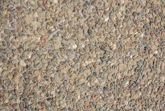 Full bakgrund för kiselstenbetonggolv, textur, closeupsikt med detaljer Royaltyfri Bild