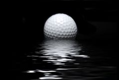 Full ball. Golf ball and water reflection royalty free stock photography