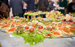 Full banquet table, eating people in background Stock Image