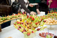 Full banquet table, eating people in background Stock Photography
