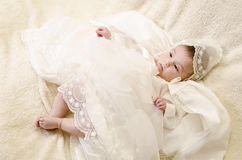 Full baptism baby. Baby and ceremonial clothes lying Stock Photos