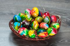 Full basket with colorful Easter hen eggs Royalty Free Stock Images