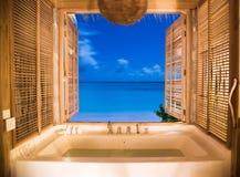 Luxury bath overlooking tropical ocean royalty free stock photos