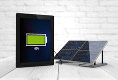 Full battery tablet. Connected to a solar panel. Digital generated Stock Photography