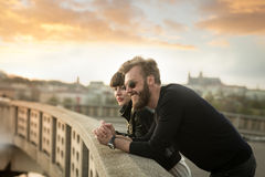 Full beard man with beautiful woman. Full beard men with beautiful women have fun in the city. Stylish couple enjoying beautiful sunset in the city from the the Stock Images