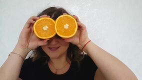 Full beautiful girl with oranges stock video
