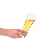 Full beer glass in hand. Stock Image