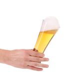 Full beer glass in hand Stock Image