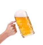 Full beer mug in hand. stock photo