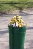 Full bin. Green dust bin full of banana skins and other garbage Royalty Free Stock Image