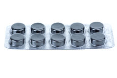 Full blister with activated carbon pills Stock Image
