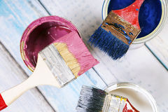 Full of blue paint tines and paint brushes on it Royalty Free Stock Photography