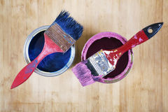 Full of blue paint tines and paint brushes on it Royalty Free Stock Photos