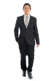 Full body Asian business people walking Royalty Free Stock Photos
