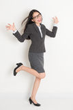 Full body Asian business woman cheering Royalty Free Stock Photo