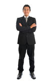 Full body Asian businessman arms crossed Royalty Free Stock Images