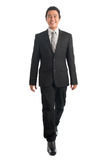 Full body Asian businesspeople walking Stock Photo