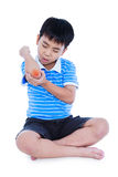 Full body of asian child injured at elbow. Isolated on white bac. Full body of asian child injured at elbow. Sad boy groaning and looking at bruise with a Stock Photography