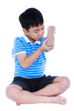 Full body of asian child injured at elbow. Isolated on white bac. Full body of asian child injured at elbow. Sad boy groaning with a painful gesture. Isolated on Royalty Free Stock Photos