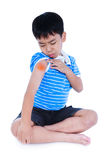 Full body of asian child injured at shoulder. Isolated on white. Full body of asian child injured at shoulder. Sad boy groaning and looking at bruise with a stock photography