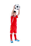 Full body of asian soccer player with football. Studio shot. Iso. Full body of young asian soccer player in red uniform holding his soccer ball, studio shot Stock Photo