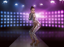 Full body of asian woman wearing silver latex suit Stock Photos