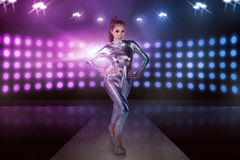 Full body of asian woman wearing silver latex suit Stock Photo