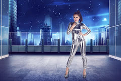 Full body of asian woman wearing silver latex suit Royalty Free Stock Image