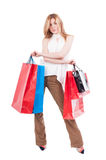 Full body of attractive woman with shopping bags Stock Photos