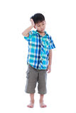 Full body. Attractive 7 year old boy making thinking expression. Stock Photos