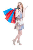 Full body of attractive young woman holding debit card Royalty Free Stock Photos