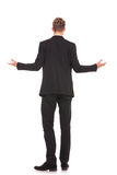 Full body back view of a business man welcoming. You on white background Stock Photo