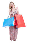 Full body of beautiful shopper female showing double peace symbo Stock Photo