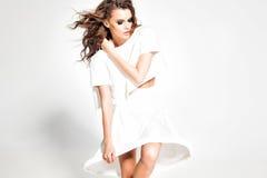 Full body of beautiful woman model posing in white dress in the studio Royalty Free Stock Image