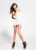 Full body of beautiful woman model posing in white dress in the studio royalty free stock photography
