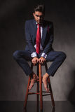 Full body of a business man sitting on a chair Royalty Free Stock Photo